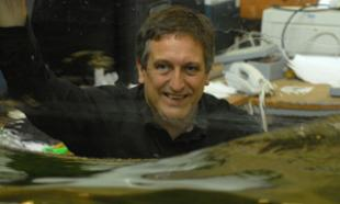 Professor Ian Bryden running wave tests in the curved tank at the Institute for Energy Systems
